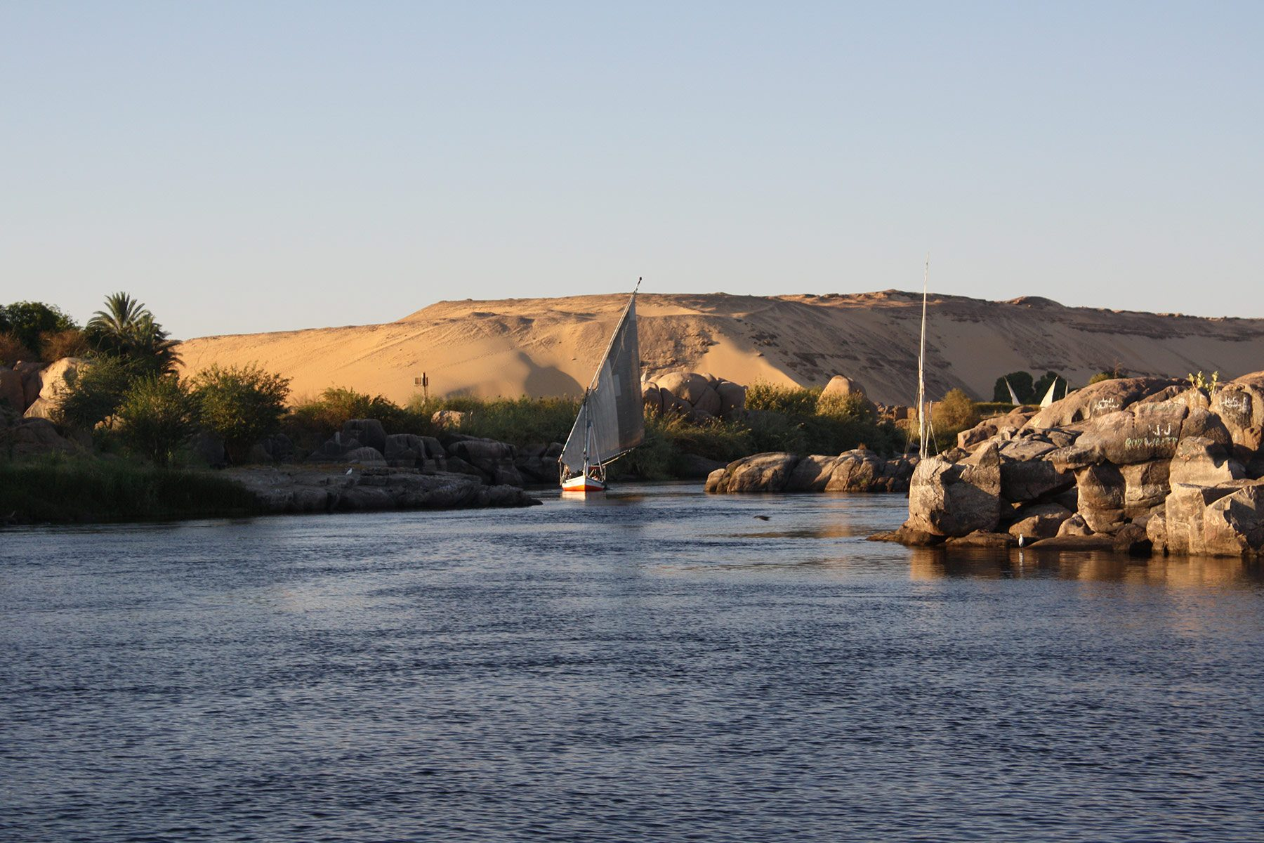 A felucca boat on a river in Egypt, by Pablo Torres on Flickr.